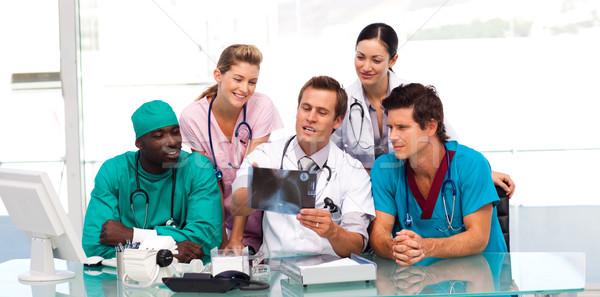 Group of doctors examining an X-ray Stock photo © wavebreak_media