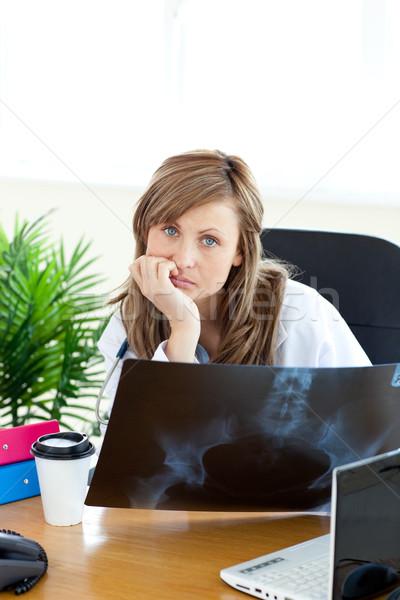 Happy female doctor holding a radiography Stock photo © wavebreak_media