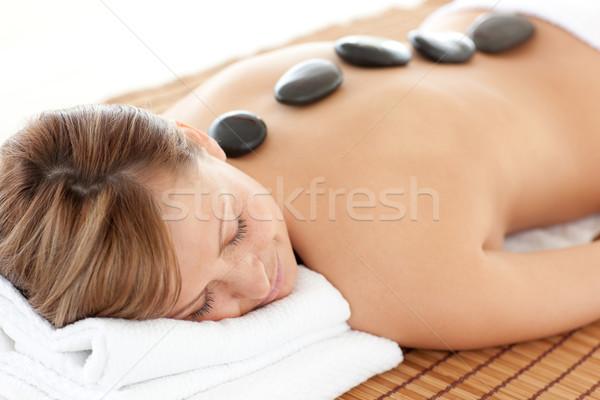Bright woman having a stone therapy Stock photo © wavebreak_media
