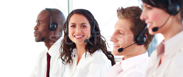 Portrait of a joyful sale representative team at work in a office Stock photo © wavebreak_media