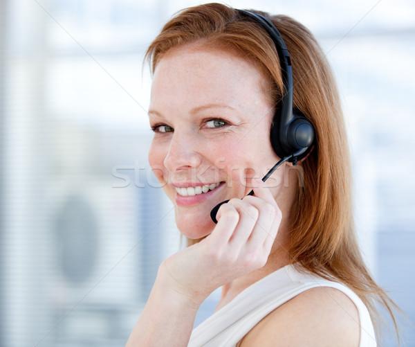 Souriant ventes représentant femme casque blanche Photo stock © wavebreak_media