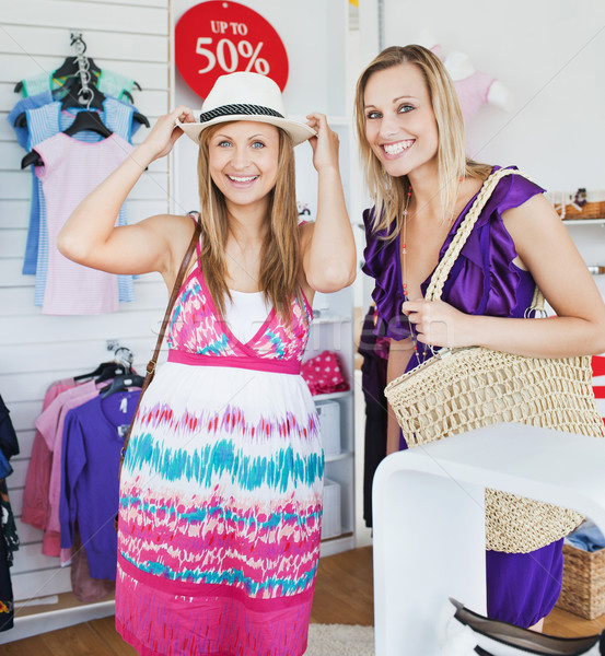 Relaxed women choosing clothes together in a shop  Stock photo © wavebreak_media
