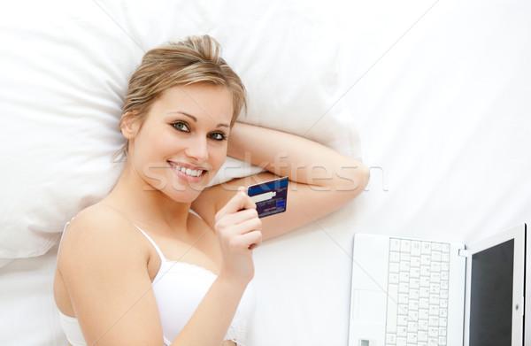 Cute woman in front of her laptop in bed Stock photo © wavebreak_media