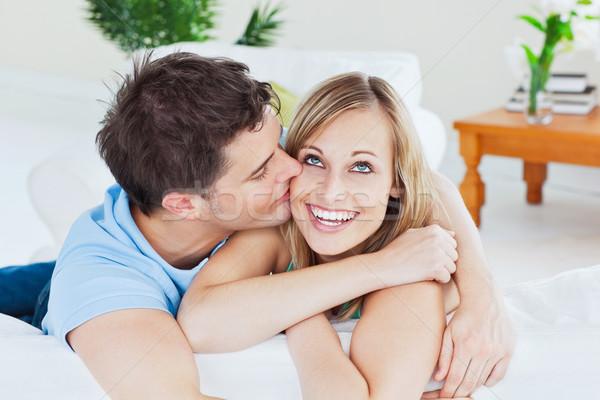 Bell'uomo bacio gioioso fidanzata entrambi divano Foto d'archivio © wavebreak_media