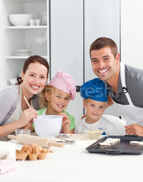Parents and children baking together in the kitchen Stock photo © wavebreak_media