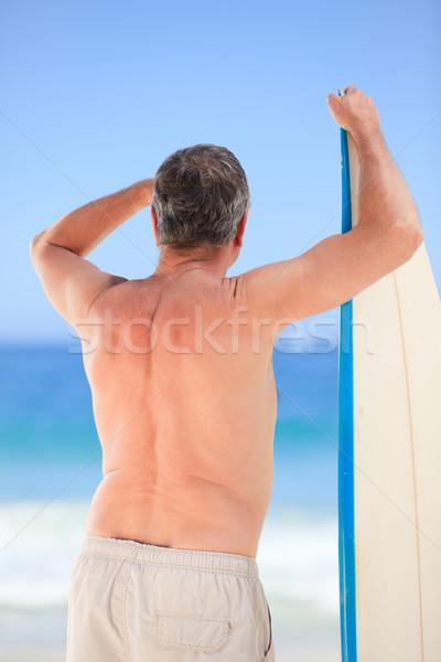 Homem maduro prancha de surfe praia sorrir esportes verão Foto stock © wavebreak_media
