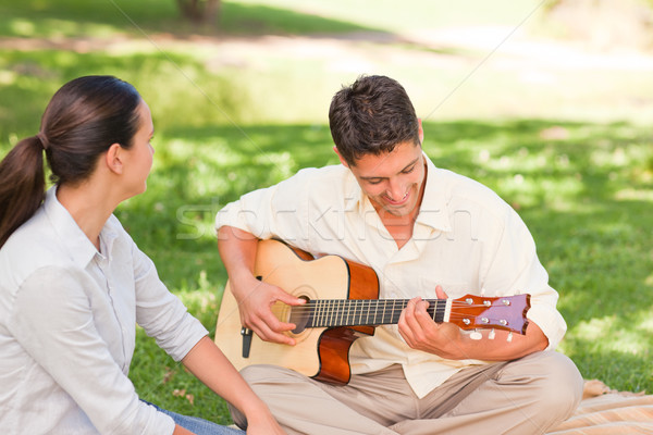 Romantic man playing guitar for his wife Stock photo © wavebreak_media