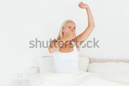Portré nő nyújtás karok hálószoba ház Stock fotó © wavebreak_media