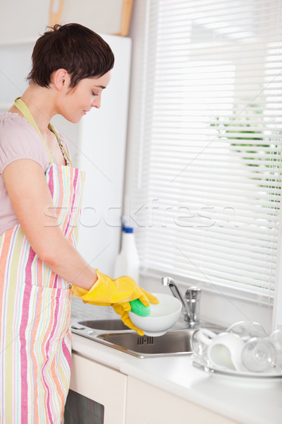 Woman washing the dishes in the kitchen Stock photo © wavebreak_media