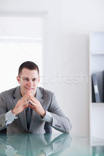 Close up of young businessman sitting behind a table in a successful negotiation Stock photo © wavebreak_media