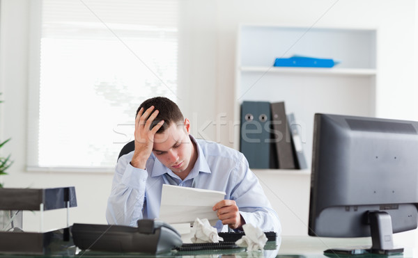 Young businessman getting frightening bad news Stock photo © wavebreak_media