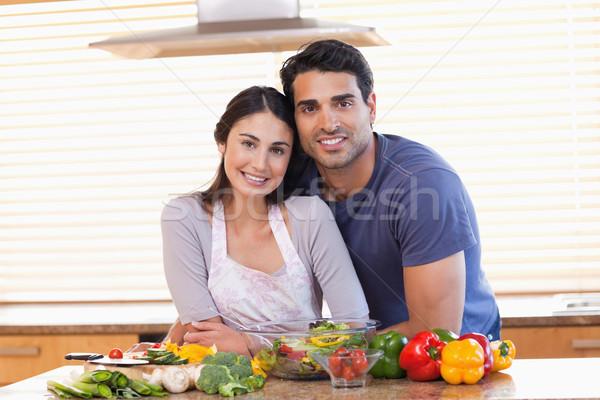 Sevimli çift bakıyor kamera mutfak sevmek Stok fotoğraf © wavebreak_media