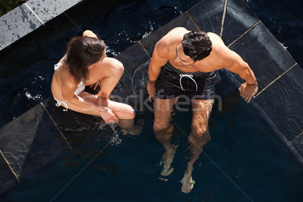 Above view of a couple talking in a swimming pool Stock photo © wavebreak_media