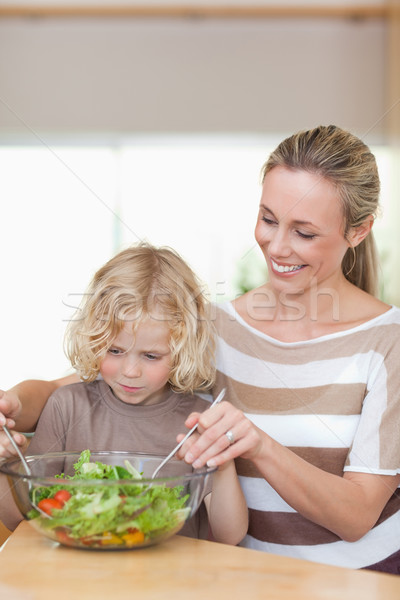 Mother and son stirring salad together Stock photo © wavebreak_media