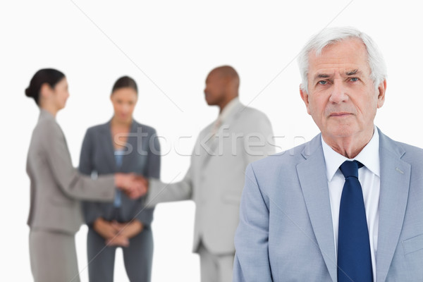 Mature businessman with trading partners behind him against a white background Stock photo © wavebreak_media