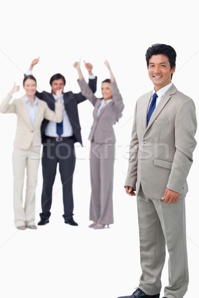 Salesman getting celebrated by his team against a white background Stock photo © wavebreak_media