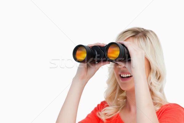 Mujer atractiva sonriendo mirando lado binoculares sonrisa Foto stock © wavebreak_media