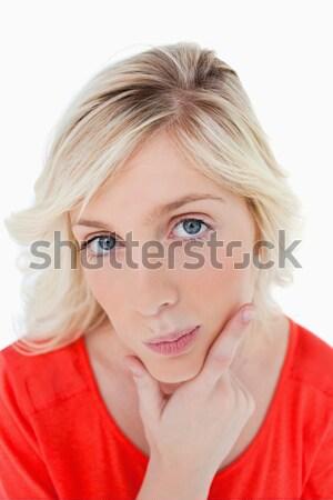 Figyelmes fiatal nő néz egyenes kamera fehér Stock fotó © wavebreak_media