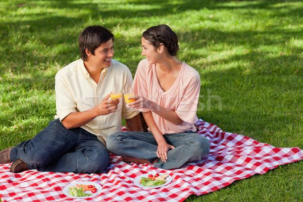 Férfi nő mosolyog szemüveg narancslé piknik étel Stock fotó © wavebreak_media
