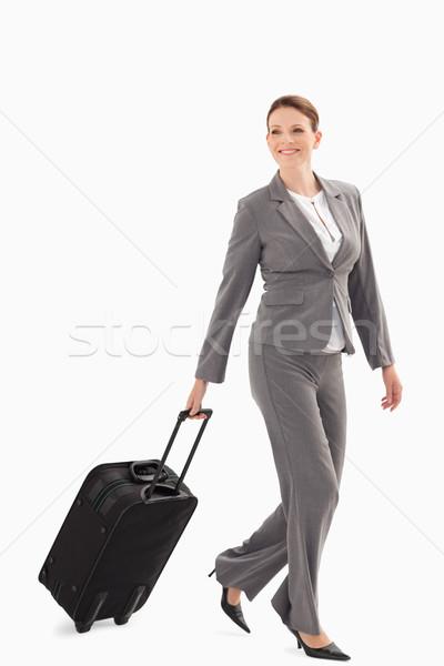 Işkadını gülen yürüyüş bavul iş moda Stok fotoğraf © wavebreak_media