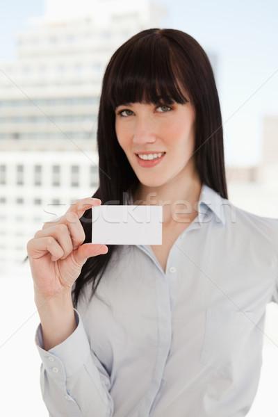 Stockfoto: Glimlachend · zakenvrouw · visitekaartje · business · glimlach