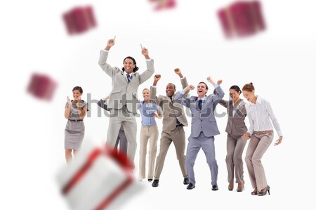 Very enthusiast people jumping and raising their arms with money falling from the sky against white  Stock photo © wavebreak_media