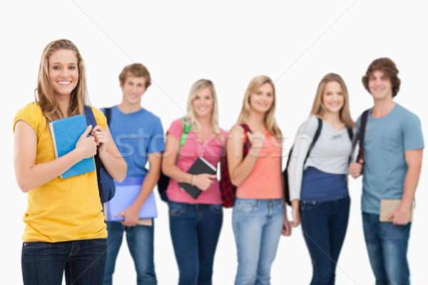 Mosolyog csoport főiskola diákok áll egy lány Stock fotó © wavebreak_media