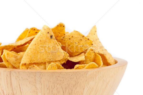 Bowl full of crisps against white background Stock photo © wavebreak_media