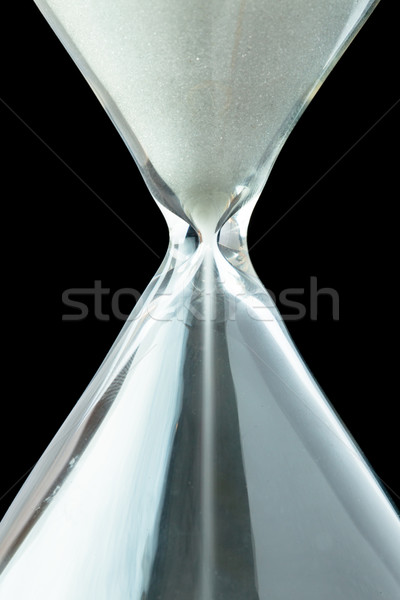 Close up of a hourglass against a black background Stock photo © wavebreak_media