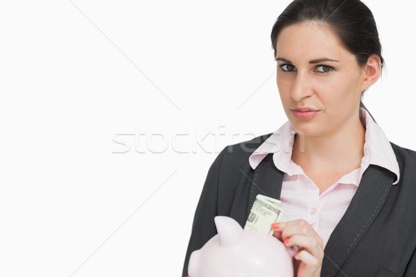Brunette femme d'affaires dollars tirelire costume Homme Photo stock © wavebreak_media