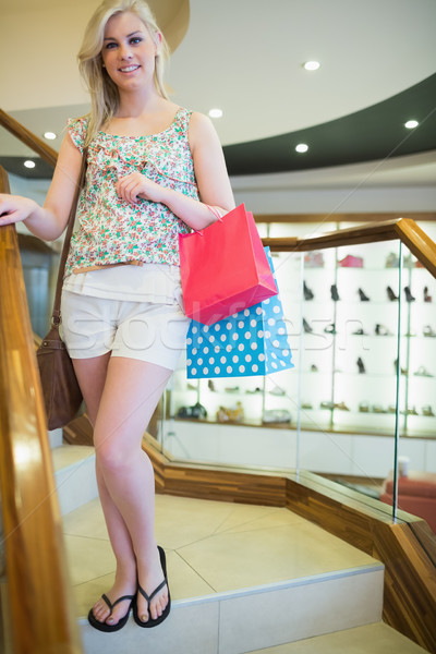 Woman standing on the stairs with shopping bags Stock photo © wavebreak_media