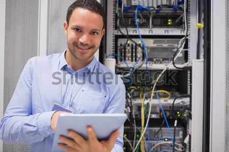 Man in data centre using a  tablet pc  Stock photo © wavebreak_media