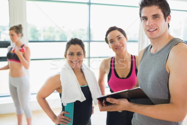 トレーナー 女性 笑みを浮かべて フィットネス スタジオ 笑顔 ストックフォト © wavebreak_media