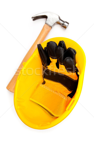 Two leather builder's gloves in a helmet with a claw hammer Stock photo © wavebreak_media