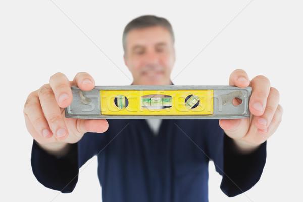 Technician holding spirit level Stock photo © wavebreak_media