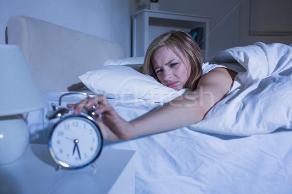 女性 ベッド 手 目覚まし時計 若い女性 ストックフォト © wavebreak_media