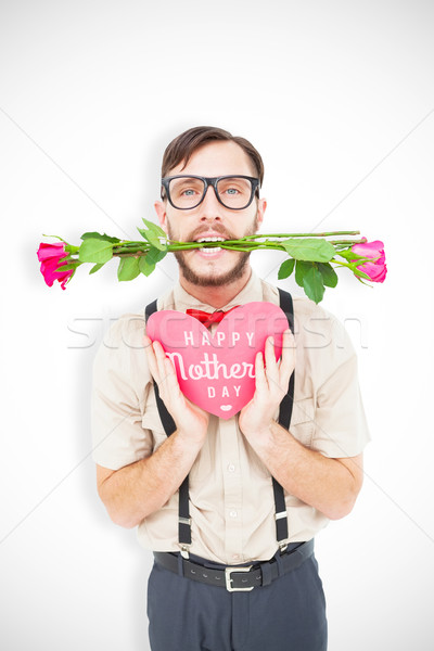 Composite image of geeky hipster offering valentines gifts Stock photo © wavebreak_media