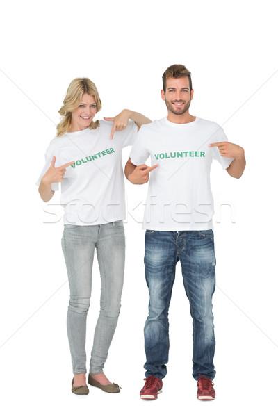 Portrait of two happy volunteers pointing to themselves Stock photo © wavebreak_media