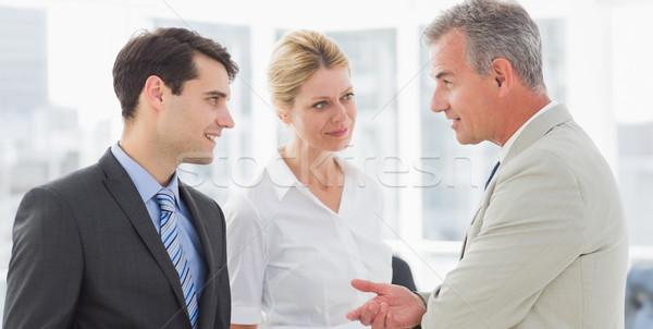 Smiling business team talking together Stock photo © wavebreak_media