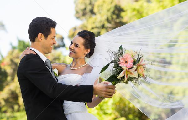 Romantic newlywed couple dancing in park Stock photo © wavebreak_media