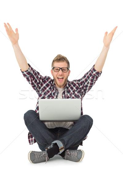 красивый мужчина камеры ноутбука сидят полу Сток-фото © wavebreak_media
