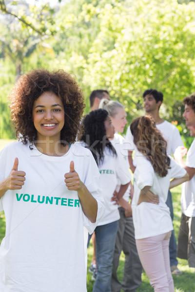 Female volunteer gesturing thumbs up  Stock photo © wavebreak_media