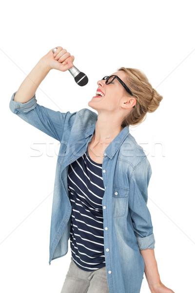 Mooie jonge vrouw zingen microfoon witte vrouwelijke Stockfoto © wavebreak_media