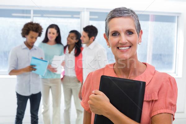 Femme d'affaires planificateur sourires caméra collègue collègues Photo stock © wavebreak_media