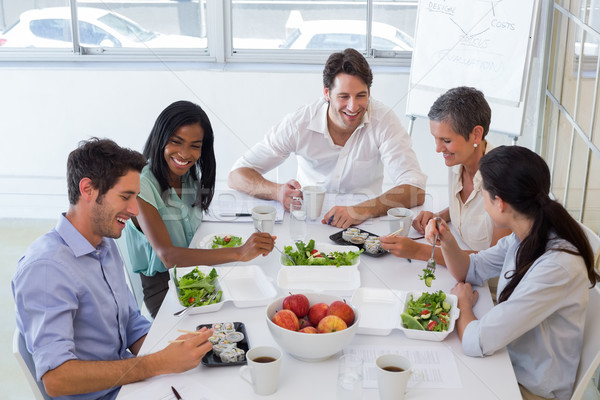 Workers chatting while enjoying healthy lunch Stock photo © wavebreak_media