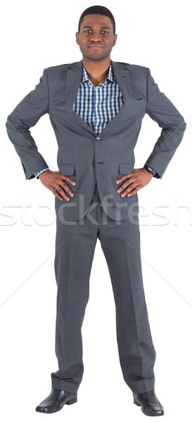 Smiling businessman with hands on hips Stock photo © wavebreak_media