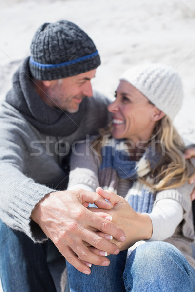 Attractive couple on the beach in warm clothing Stock photo © wavebreak_media