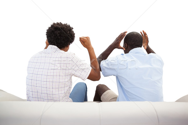 Rival esportes fãs sessão sofá branco Foto stock © wavebreak_media