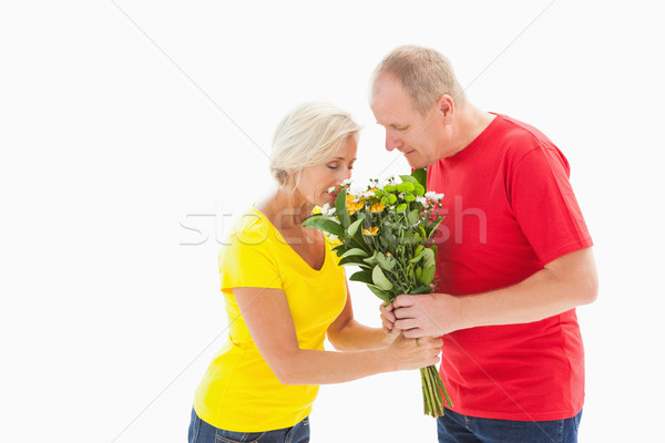 Mature man offering his partner flowers Stock photo © wavebreak_media