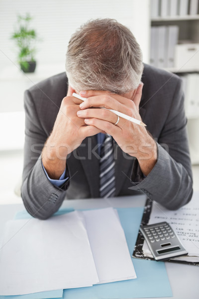 Stressed businessman with head in hands Stock photo © wavebreak_media